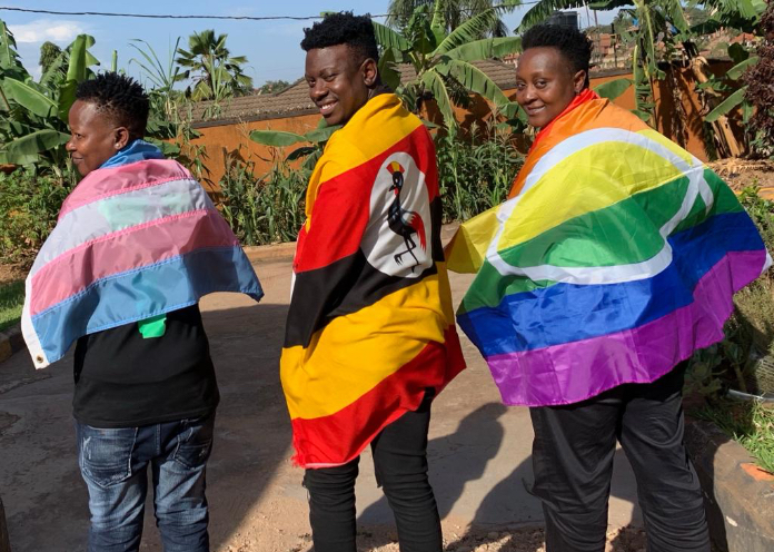 3 people with pride flag