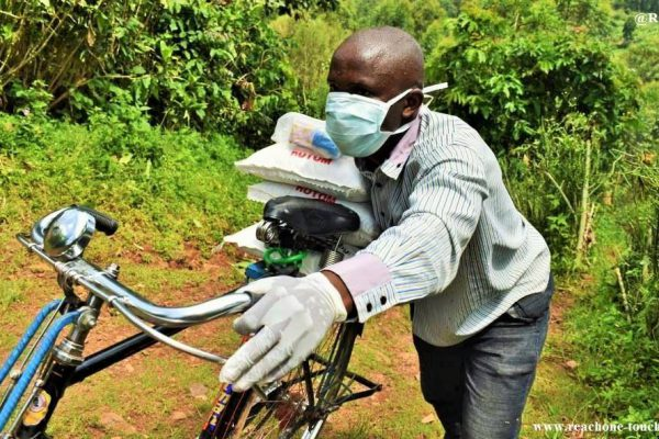 man with supplies on bike