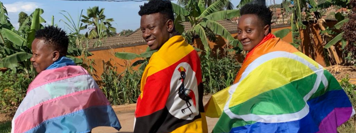 three people with pride flags