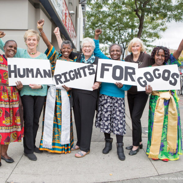 grandmothers holding signs which read human rights for gogos